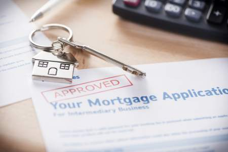 mortgage loan application paper with approved stamp in red