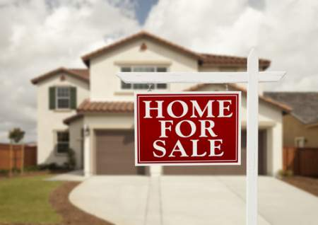 selling a house with sign in yard that says home for sale