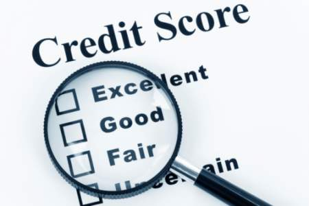 credit score concept with magnifying glass over words