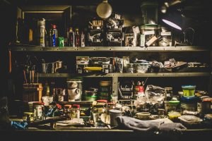 A picture of a workshop shelf with lots of clutter
